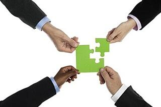 Teamwork_-_4_arms_connecting_puzzle_pieces-1.jpg