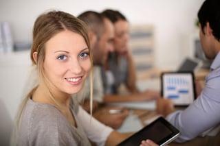 Portrait of business girl attending meeting.jpeg
