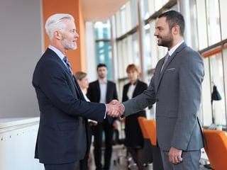 business partners, partnership concept with two businessman handshake-1.jpeg