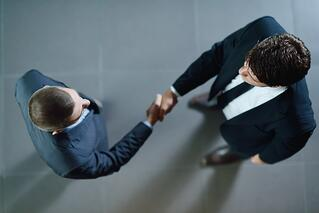 business people shaking hands make deal and sign contract.jpeg